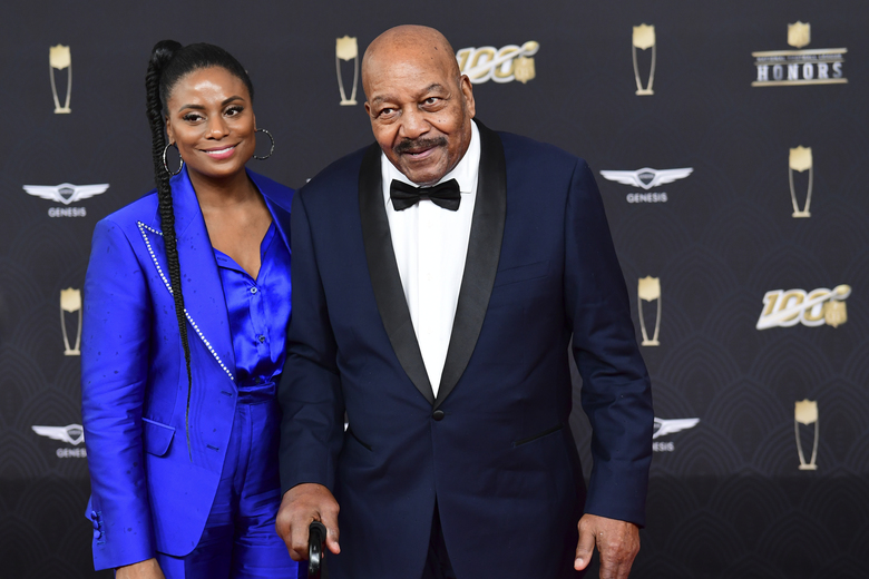 IMAGE DISTRIBUTED FOR NFL – From left, Monique Brown and Jim Brown arrive at the 9th Annual NFL Honors at the Adrienne Arsht Center in Miami on Saturday, Feb. 1, 2020. (Joy Asico/AP Images for NFL)