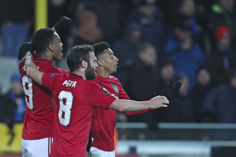 Manchester United's Anthony Martial, left, celebrates with teammates after scoring his side's first goal during an Europa League round of 32 first leg soccer match between Brugge and Manchester United at the Jan Breydel stadium in Bruges, Belgium, Thursday, Feb. 20, 2020. Martial scored once and the match ended in a 1-1 draw. (AP Photo/Francisco Seco)