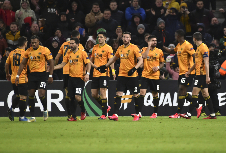 Wolverhampton Wanderers' Ruben Neves, third right, celebrates after scoring his side's second goal during the Europa League round of 32 match between Wolverhampton Wanderers and Espanyol at the Molineux Stadium, in Wolverhampton, England, Thursday, Feb. 20, 2020. (AP Photo/ Rui Vieira)