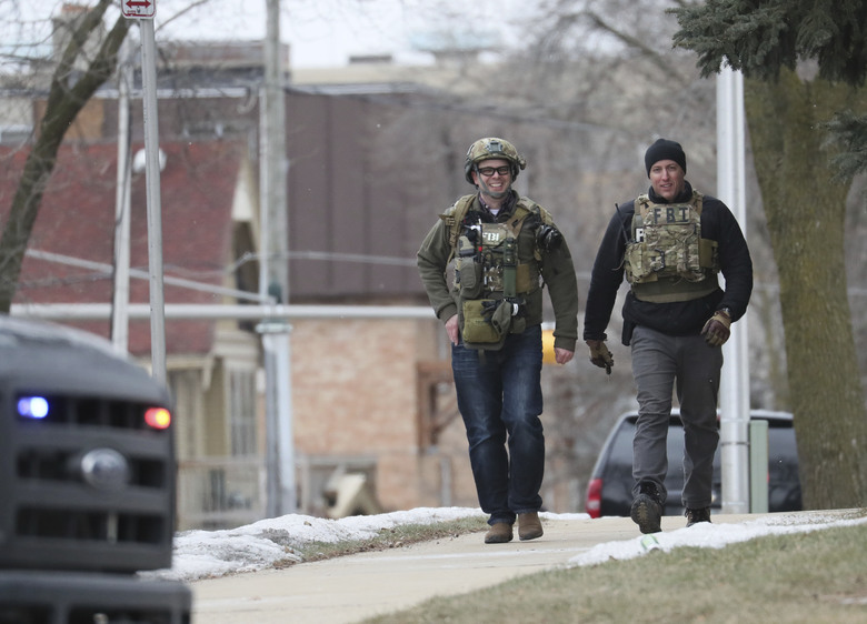FBI agents in tactical gear respond to reports of an active shooter at the Molson Coors Brewing Co. campus in Milwaukee, Wednesday, Feb. 26, 2020. (Michael Sears/Milwaukee Journal-Sentinel via AP)