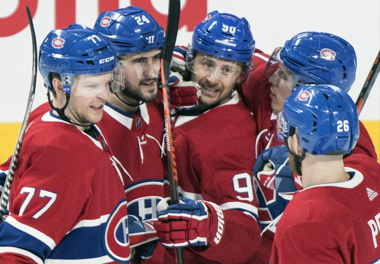 Montreal Canadiens' Tomas Tatar (90) celebrates with teammates Brett Kulak (77), Phillip Danault (24), Brendan Gallagher (11) and Jeff Petry (26) after scoring during the second period of an NHL hockey game against the Florida Panthers, Saturday, Feb. 1, 2020 in Montreal. (Graham Hughes/The Canadian Press via AP)