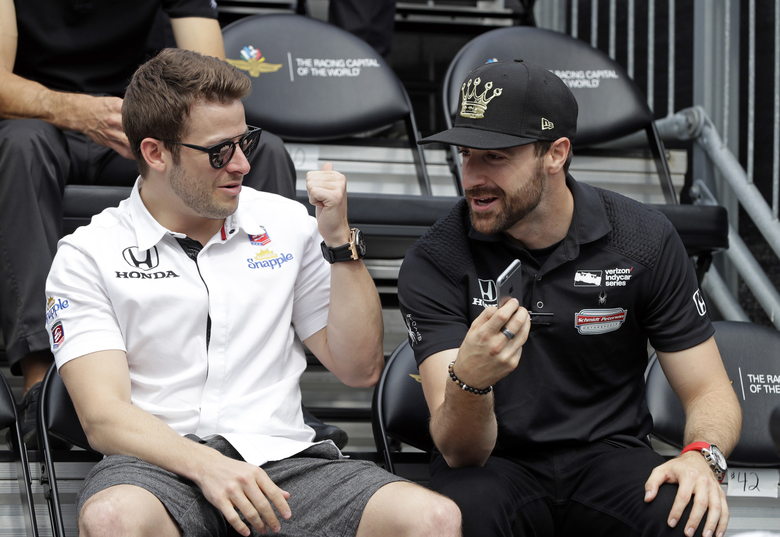 FILE – In this May 28, 2016, file photo, James Hinchcliffe, right, of Canada, talks with Marco Andretti during the drivers meeting for the Indianapolis 500 auto race at Indianapolis Motor Speedway in Indianapolis. Hinchcliffe will return to Andretti Autosport for three races this season, including the Indianapolis 500. (AP Photo/Darron Cummings, File)