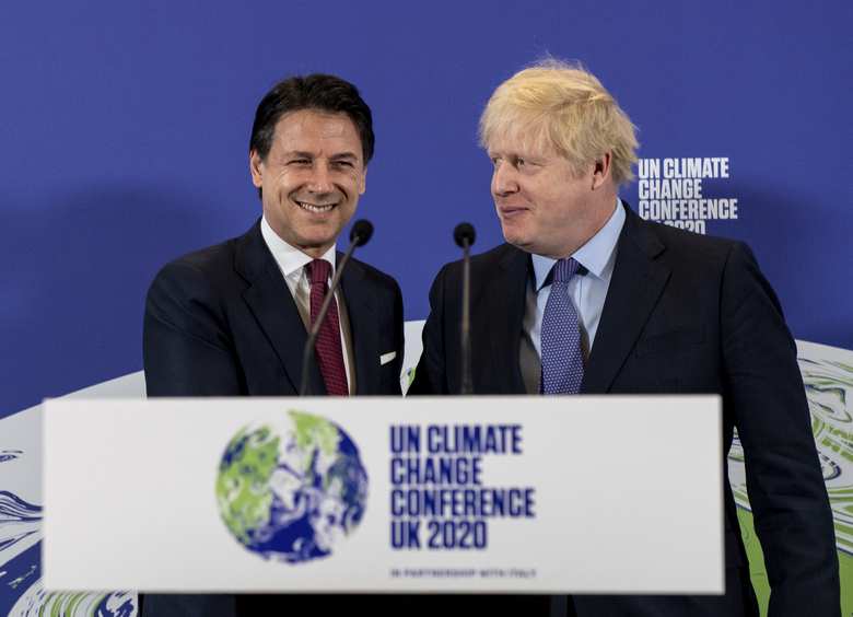 Britain's Prime Minister Boris Johnson, right, and Italy's Prime Minister Giuseppe Conte attend the launch of the upcoming UK-hosted COP26 UN Climate Summit in London, Tuesday Feb. 4, 2020, that will take place in autumn 2020 in Glasgow, Scotland. Johnson is expected to announce a target to stop selling new petrol and diesel vehicles by 2035, including hybrid vehicles for the first time. (Chris J Ratcliffe/Pool via AP)