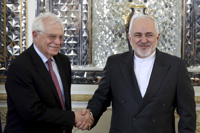 FILE – In this Monday, Feb 3, 2020, file photo, Iranian Foreign Minister Mohammad Javad Zarif, right, and European Union foreign policy chief Josep Borrell, shake hands for journalists prior to their meeting, in Tehran, Iran. Now that Britain has left the bloc, the EU hopes to find more time concentrate on its foreign policy. (AP Photo/Ebrahim Noroozi, File)