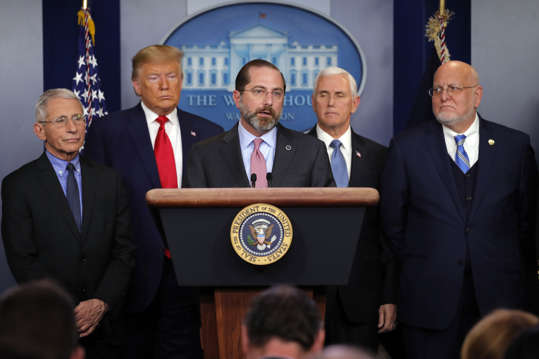 Health and Human Services Secretary Alex Azar speaks as National Institute for Allergy and Infectious Diseases Director Dr. Anthony Fauci, President Donald Trump, Vice President Mike Pence and Robert Redfield, director of the Centers for Disease Control and Prevention, listen, during a briefing about the coronavirus  in the press briefing room at the White House in Washington, Saturday, Feb. 29, 2020.( AP Photo/Carolyn Kaster)