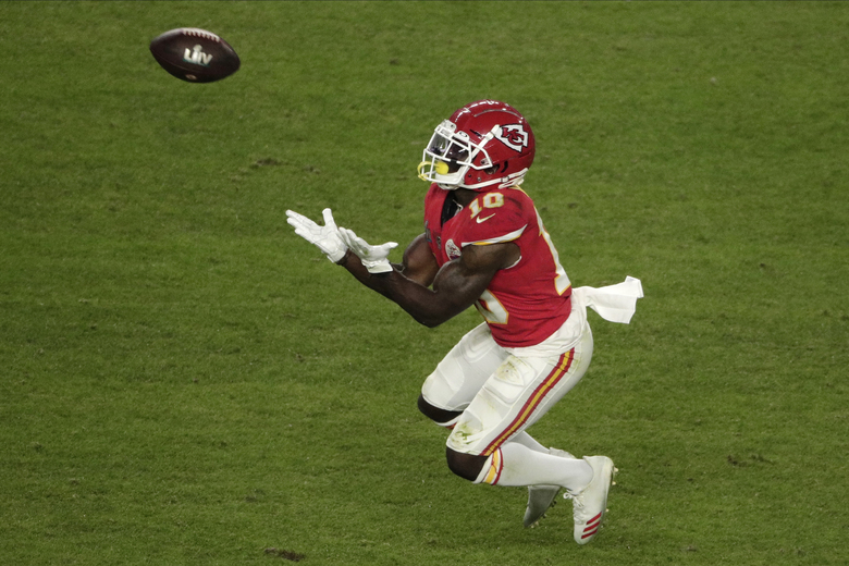 Kansas City Chiefs' Tyreek Hill (10) catches a pass, during the second half of the NFL Super Bowl 54 football game against the San Francisco 49ers, Sunday, Feb. 2, 2020, in Miami Gardens, Fla. (AP Photo/Charlie Riedel)