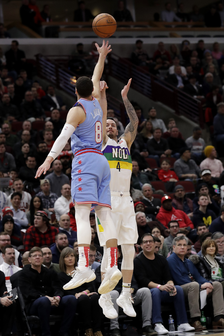 New Orleans Pelicans guard JJ Redick, right, shoots over Chicago Bulls guard Zach LaVine during the first half of an NBA basketball game in Chicago, Thursday, Feb. 6, 2020. (AP Photo/Nam Y. Huh)