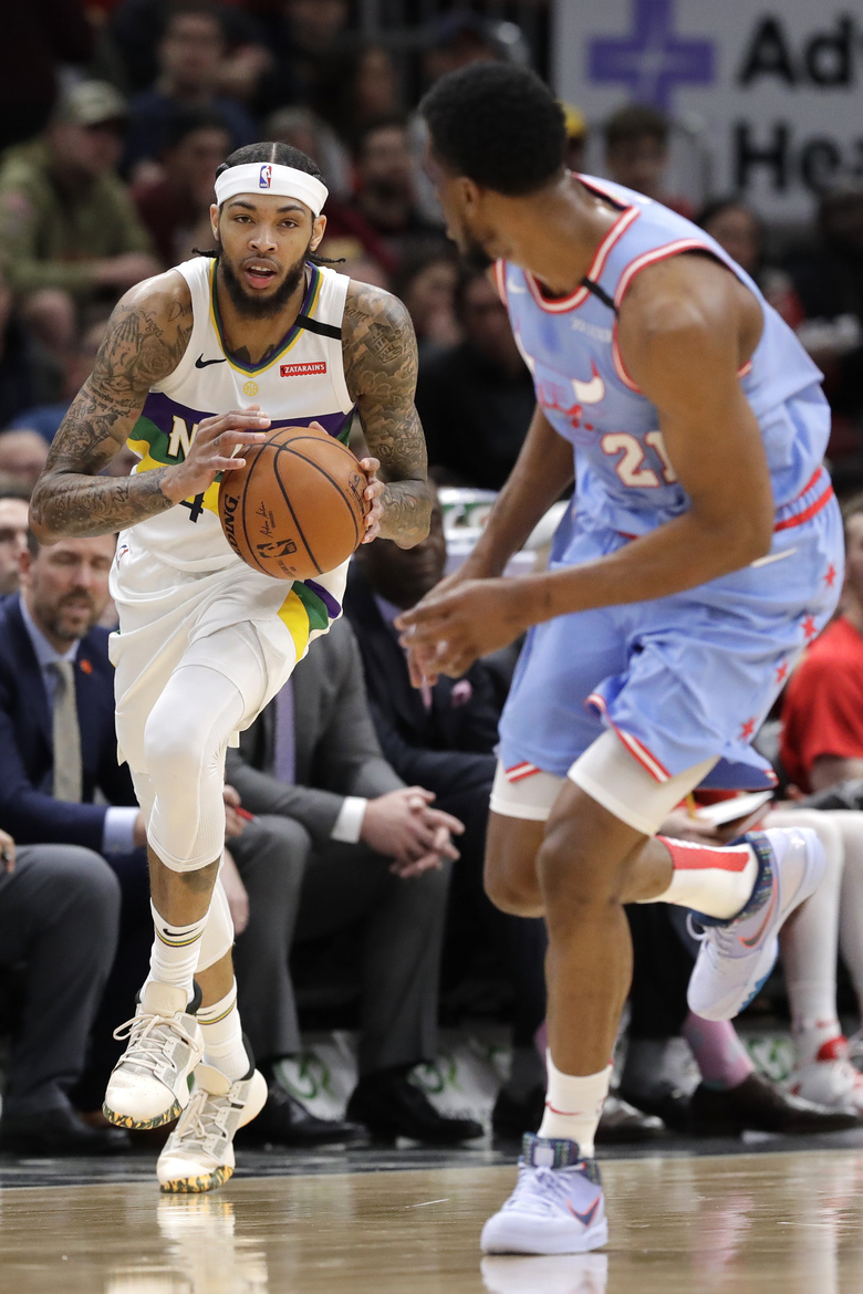 New Orleans Pelicans forward Brandon Ingram, left, drives against Chicago Bulls forward Thaddeus Young during the first half of an NBA basketball game in Chicago, Thursday, Feb. 6, 2020. (AP Photo/Nam Y. Huh)