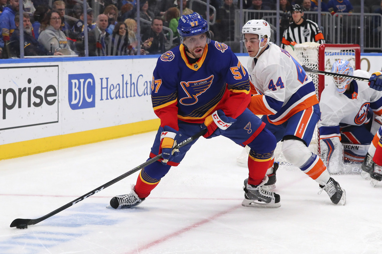 St. Louis Blues left wing David Perron (57) looks to pass the puck against New York Islanders center Jean-Gabriel Pageau (44) during the second period of an NHL hockey game Thursday, Feb. 27, 2020, in St. Louis. (AP Photo/Dilip Vishwanat)