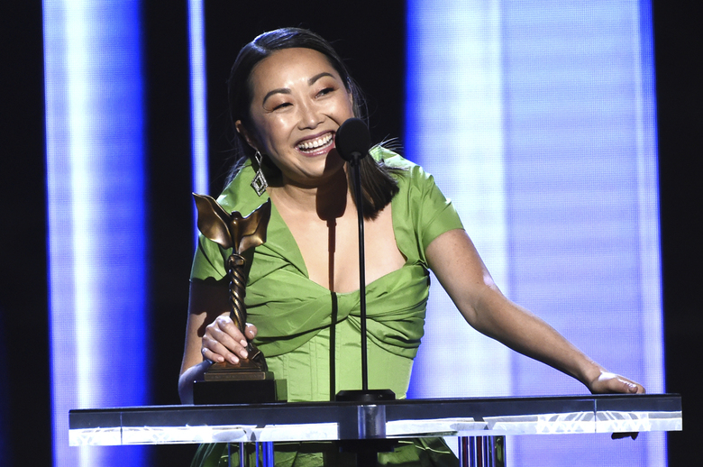 """On behalf of Zhao Shuzhen, Director Lulu Wang accepts the award for best supporting female for """"The Farewell"""" at the 35th Film Independent Spirit Awards on Saturday, Feb. 8, 2020, in Santa Monica, Calif. (AP Photo/Chris Pizzello)"""