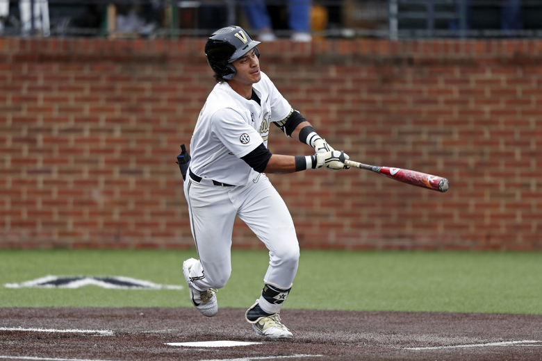 FILE – In this March 11, 2019, file photo, Vanderbilt's Austin Martin connects for a hit during an NCAA college baseball game against Missouri in Nashville, Tenn. Martin is widely considered the best pure hitter in the nation and is in contention to be the No. 1 overall draft pick. His SEC-leading .392 batting average was highest by a Vandy player since 2004. (AP Photo/Wade Payne, File)