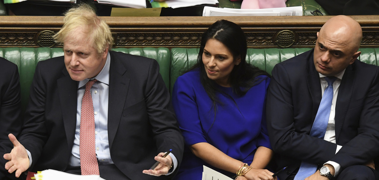Britain's Prime Minister Boris Johnson reacts during the weekly Prime Minister's Questions inside the House of Commons in London, Wednesday Jan. 29, 2020.  Britain is scheduled to leave Europe from the stroke of midnight on upcoming Friday, with the future relationship between the trading partners to be defined by continuing trade negotiations.  Chancellor of the Exchequer Sajid Javid, right, and Home Secretary Priti Patel, 2nd right. (Jessica Taylor/House of Commons via AP)
