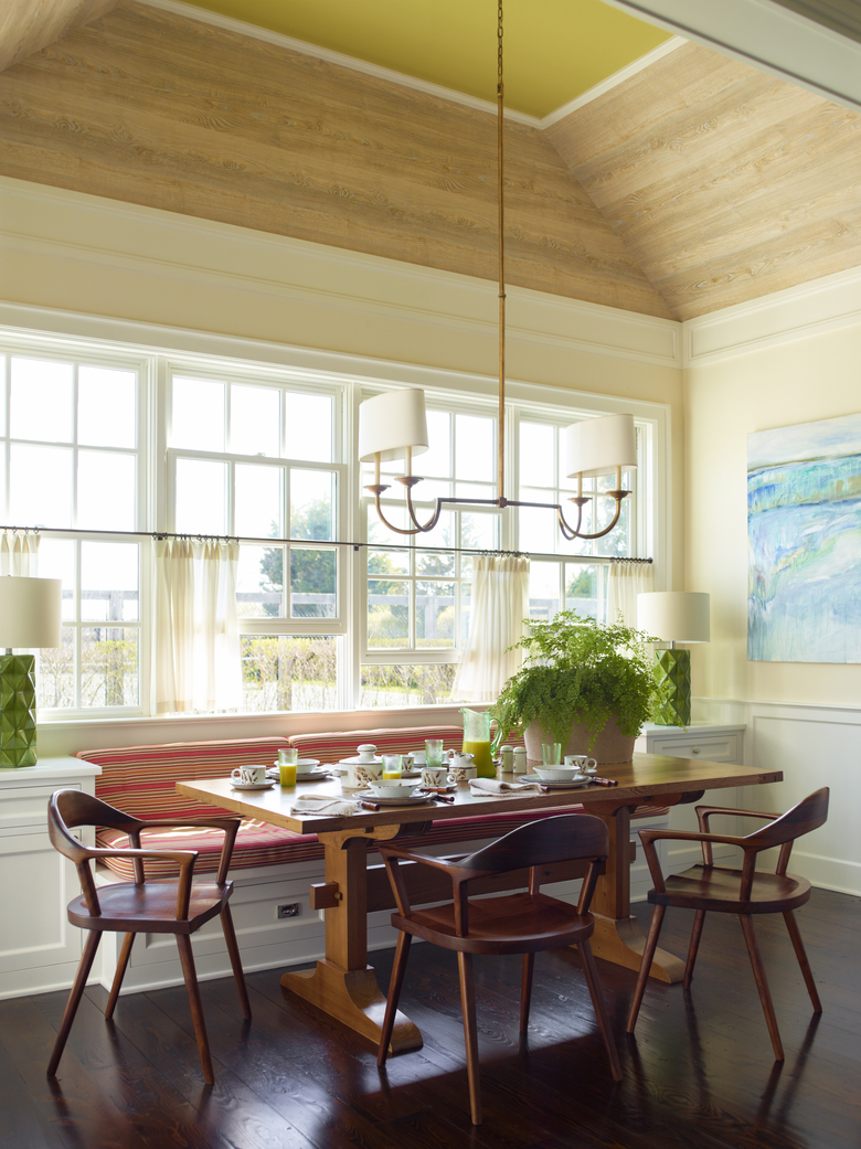 This undated photo shows a kitchen designed by Gideon Mendelson in a Hamptons retreat in New York. In the home, Mendelson's team used faux wood wallcovering from French firm Nobilis to add a beachy feel to the ceiling, punctuated with fresh Lilly Pulitzer-esque green paint. (Eric Piasecki/Gideon Mendelson/Mendelson Group via AP)