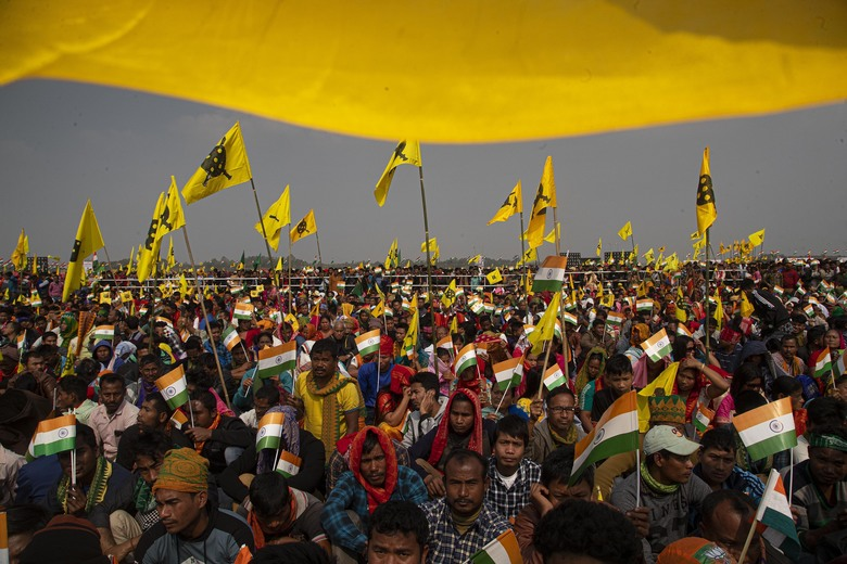 Bodo tribals attend an event to celebrate signing of a peace accord with the Bodo rebel group, National Democratic Front of Bodoland, in Kokrajhar, a town 250 kilometers (150 miles) west of Gauhati, India, Friday, Feb. 7, 2020. Modi said on Friday that his government will continue its peace push in insurgency-wracked northeast bordering China and Myanmar where signing of accords with key rebel groups led to surrender by thousands of fighters. The prime minister said decades of violent insurrection ended in the Bodo tribal heartland in Assam state following the signing of the Jan. 27 agreement by the government with the rebel group. (AP Photo/Anupam Nath)