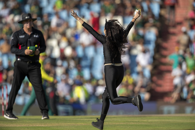 A pitch invader runs onto the field during the final T20 cricket match between South Africa and England at Centurion Park in Pretoria, South Africa, Sunday, Feb. 16, 2020. (AP Photo/Themba Hadebe)