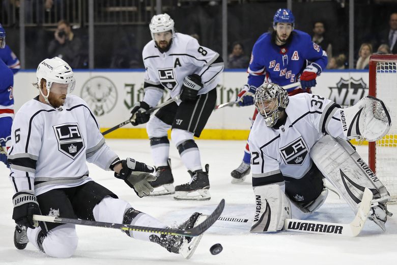 Los Angeles Kings defenseman Joakim Ryan (6) deflects a shot by the New York Rangers past Los Angeles Kings goaltender Jonathan Quick (32) in the second period of an NHL hockey game Sunday, Feb. 9, 2020, in New York. (AP Photo/Adam Hunger)