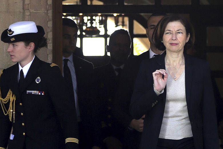 France's Defense Minister Florence Parly, right, leaves the Presidential Palace after talks with Cypriot President Nicos Anastasiades in capital Nicosia, Cyprus, Tuesday, Feb. 18, 2020. Parly said on Tuesday that her country stands in solidarity with Cyprus amid tensions over a Turkish search for natural gas inside Cypriot waters. (AP Photo/Petros Karadjias)