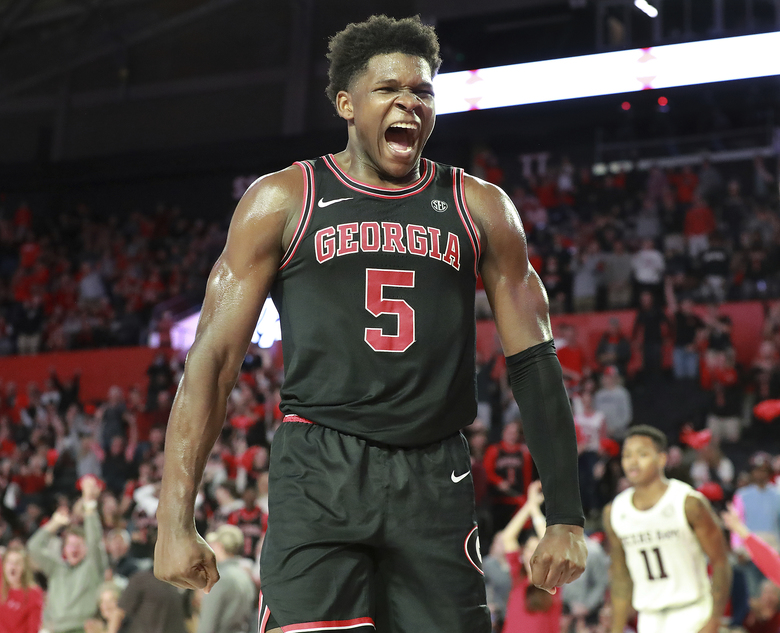 Georgia guard Anthony Edwards reacts to his break away dunk against Texas A&M during the second half in a NCAA college basketball game on Saturday, Feb. 1, 2020, in Athens. (Curtis Compton/Atlanta Journal-Constitution via AP)