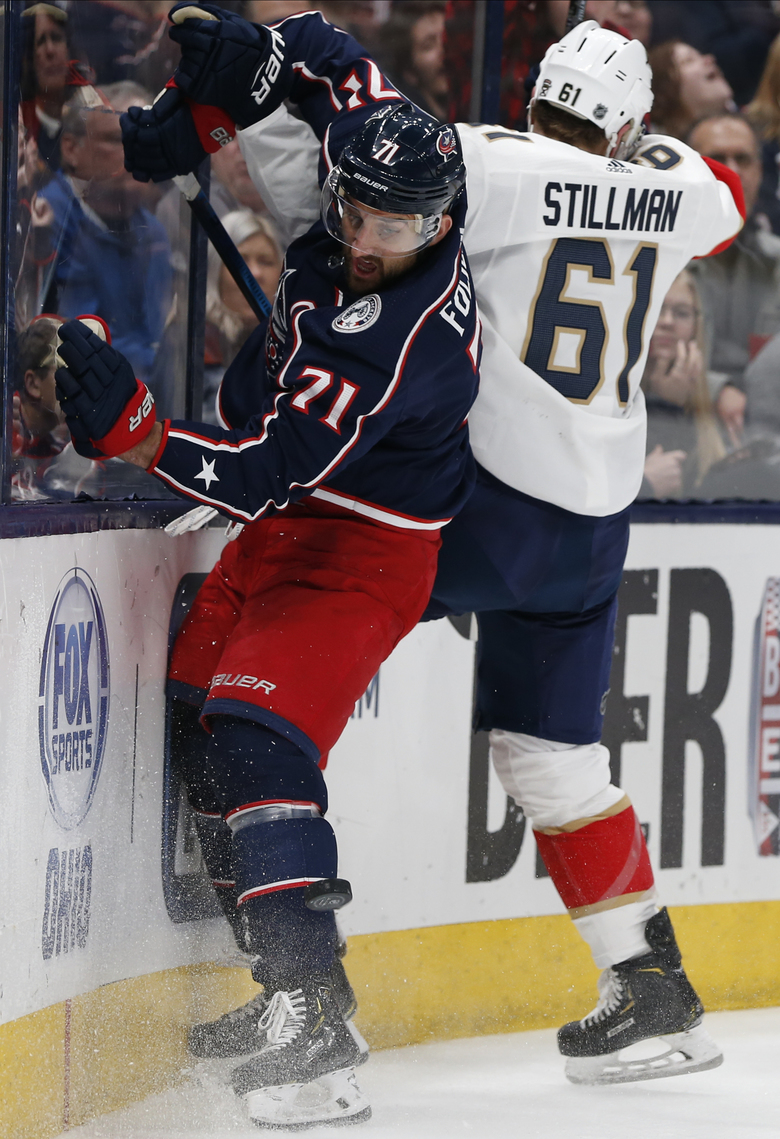 Florida Panthers' Riley Stillman, right, checks Columbus Blue Jackets' Nick Foligno during the second period of an NHL hockey game Tuesday, Feb. 4, 2020, in Columbus, Ohio. (AP Photo/Jay LaPrete)