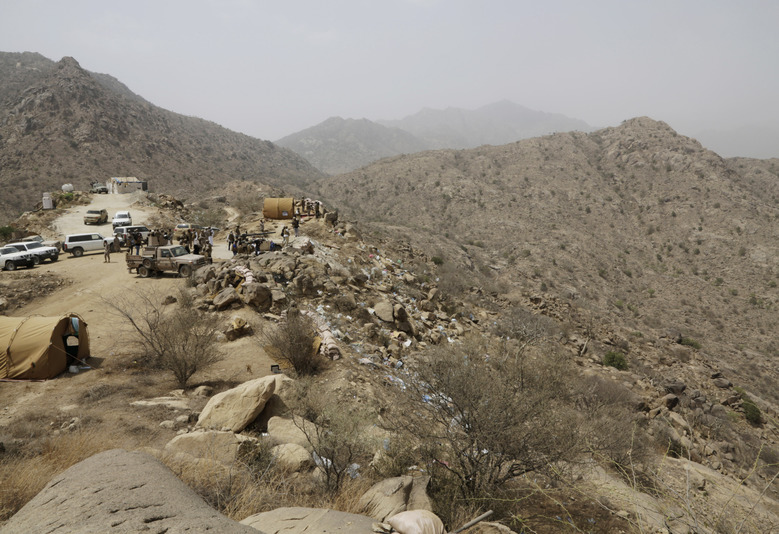 FILE – In this April 20, 2015 file photo, Saudi soldiers work at the border with Yemen in Jazan, Saudi Arabia. Houthi rebels in Yemen have blocked half of the United Nations' aid delivery programs in the war-torn country — a strong-arm tactic to force the agency to give them greater control over the massive humanitarian campaign, along with a cut of billions of dollars in foreign assistance, according to aid officials and internal documents obtained by The Associated Press. (AP Photo/Hasan Jamali, File)