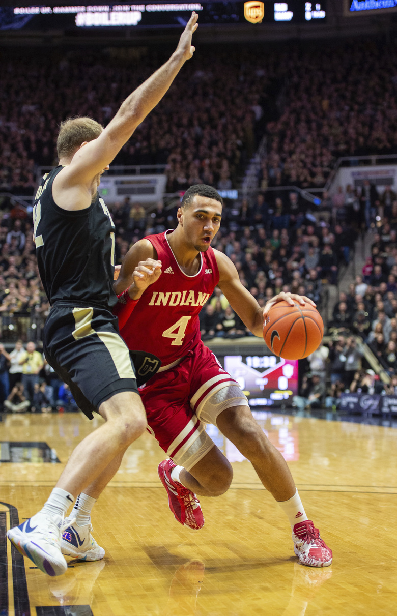 Indiana forward Trayce Jackson-Davis (4) drives the ball toward the basket as Purdue forward Evan Boudreaux, left, defends during the first half of an NCAA college basketball game Thursday, Feb. 27, 2020, in West Lafayette, Ind. (AP Photo/Doug McSchooler)