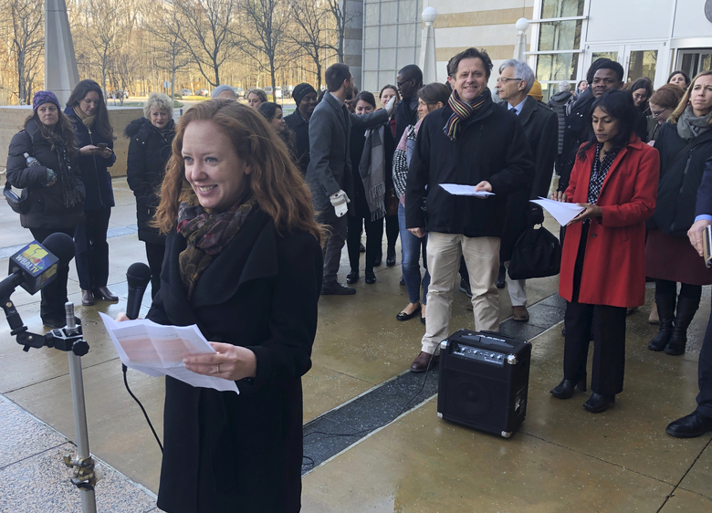FILE – In this Jan. 8, 2020, file photo, Linda Evarts, an attorney for the International Refugee Assistant Project, speaks to the media outside the federal courthouse in Greenbelt, Md.   The federal government is appealing a judge's decision to block the Trump administration from enforcing an executive order allowing state and local governments to turn away refugees from resettling in their jurisdictions. A notice of appeal filed Tuesday, Feb. 11,  by the Justice Department says it is asking the 4th U.S. Circuit Court of Appeals to review the Jan. 15 ruling by U.S. District Judge Peter Messitte in Maryland.(AP Photo/Michael Kunzelman, File)