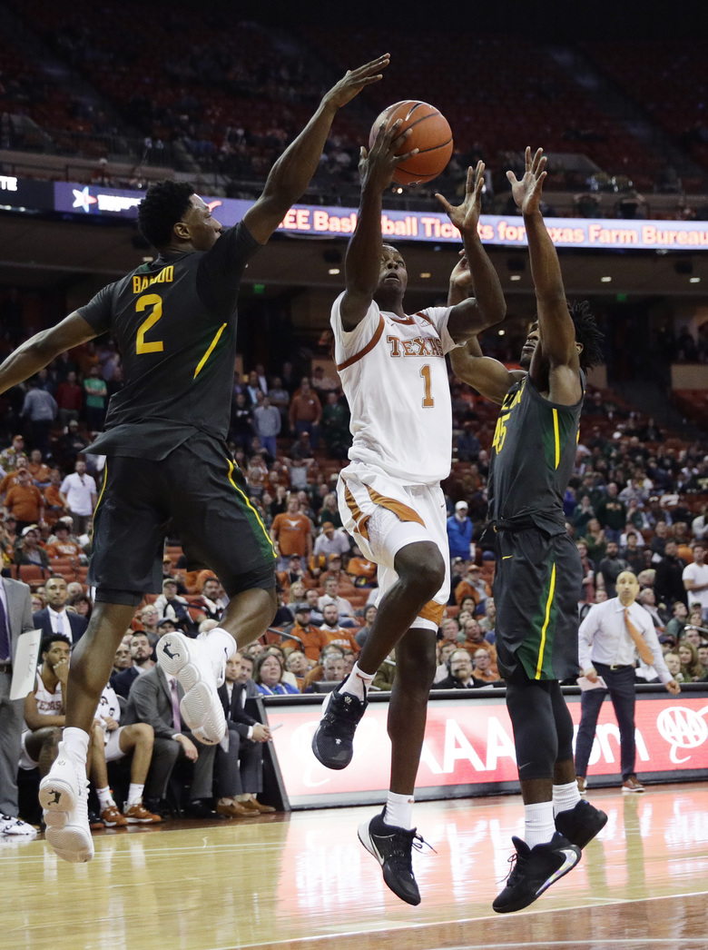 Texas guard Andrew Jones (1) is blocked as he tries to score by Baylor guard Devonte Bandoo (2) during the second half of an NCAA college basketball game, Monday, Feb. 10, 2020, in Austin, Texas. (AP Photo/Eric Gay)