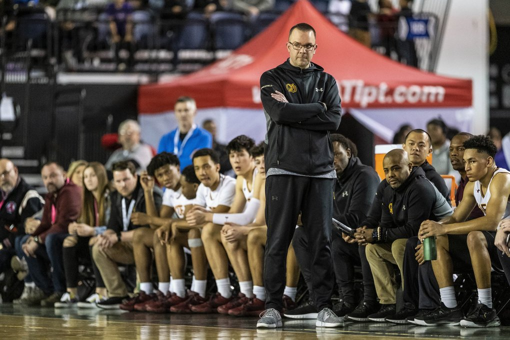 O'Dea coach Jason Kerr can only watch as the Garfield Bulldogs go on a run in the second nd half to put the game out of hand Saturday. (Dean Rutz / The Seattle Times)