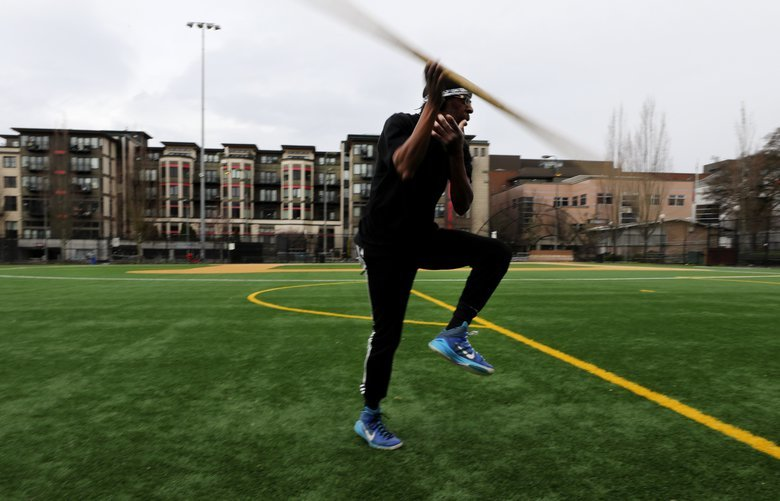 David Savanah works out at Bobby Morris Playfield doing Korean martial arts moves as he listens to Reggae music on his earphones.  The 59-year-old does this three times a week for one-hour-sessions.   He's been practicing this for two decades.  It's called Kuk Sool Won.  LO workout with staff on Saturday March 14, 2020 213344