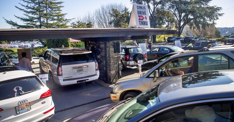 Customers filled Canlis' parking lot to grab drive-thru food on Monday. (Mike Siegel / The Seattle Times)