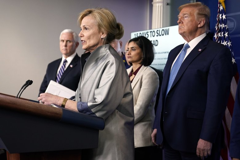 President Donald Trump listens as Dr. Deborah Birx, White House coronavirus response coordinator, speaks in the Brady press briefing room at the White House, Monday, March 16, 2020, in Washington. Brix cited British analysis at a Monday's news conference, saying her response team was especially focused on the report's conclusion that an entire household should self-quarantine for 14 days if one of its members is stricken by the virus. (Evan Vucci / The Associated Press)