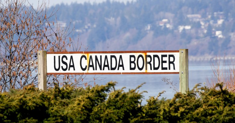 This sign at Peace Arch Park Border Crossing in Blaine is a familiar sight to those crossing the border for work, to pick up packages or shop. (Mike Siegel / The Seattle Times)