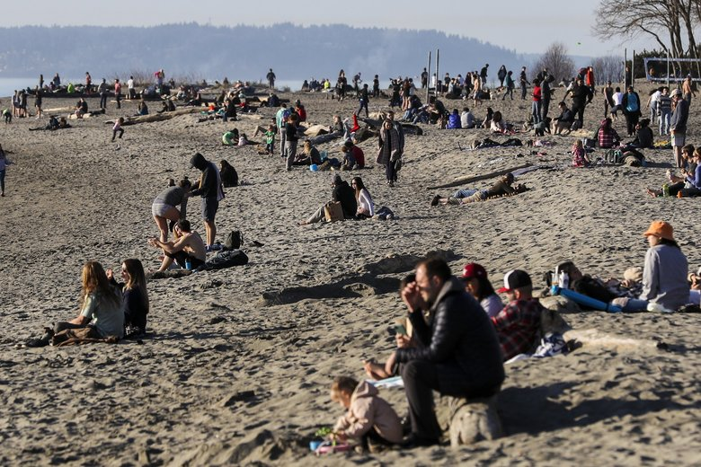 Seattle's Golden Gardens is packed on Wednesday afternoon. With social distancing encouraged and bars and nightclubs restricted to takeout, FYI Guy takes a look at who's managing better: millennials, baby boomers or the ones in the middle, Generation X.  (Amanda Snyder / The Seattle Times)