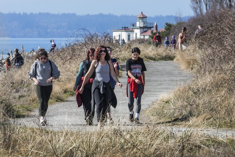 Walkers on South Beach Trail in the sunshine at Seattle's Discovery Park on Thursday. (Steve Ringman / The Seattle Times)