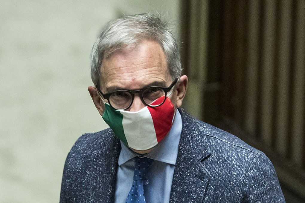 Lawmaker Roberto Novelli wears a face mask in the colors of the Italian flag as he arrives for a session of the Italian Chamber of Deputies, in Rome, on Tuesday.   (Roberto Monaldo / The Associated Press)