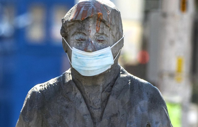 Tuesday, March 31, 2020.   The sculpture, People Waiting for the Interurban in Fremont has a small bit of protection as they bare witness to Covid-19.   The CDC weighing new advice on masks, experts say it won't hurt unless you take from medical workers.  213520 213520