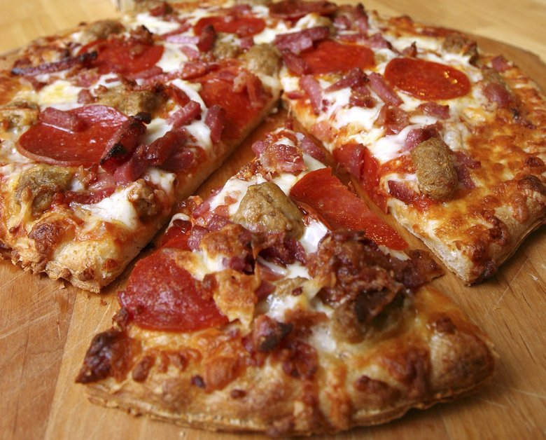 "While stuck at home, watch aimless snacking, but relax your food rules — but that doesn't mean a diet of all frozen pizza. Not that there's anything wrong with frozen pizza, but there's a lot of ground between trying to eat ""perfectly"" and throwing everything to the wolves. (Larry Crowe / The Associated Press)"