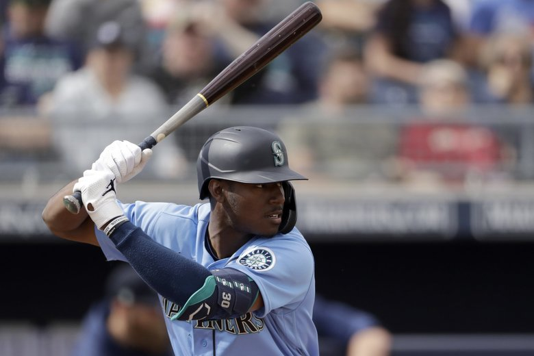 Seattle Mariners' Kyle Lewis bats during the fourth inning of a spring training baseball game against the Colorado Rockies Monday, March 2, 2020, in Peoria, Ariz. (AP Photo/Charlie Riedel) OTKCR OTKCR (Charlie Riedel / The Associated Press)