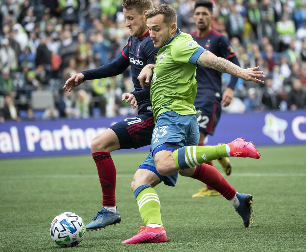 Jordan Morris looks to put up a shot on Chicago's Fabian Herbers in the 2nd half.  The Chicago Fire played the Seattle Sounders in the MLS opener for both teams Sunday, March 1, 2020 at CenturyLink Field in Seattle, WA. 213133 (Dean Rutz / The Seattle Times)