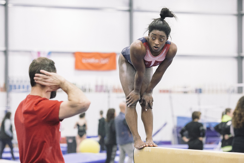 Simone Biles, practices with her coach, Laurent Landi, at a training camp  in Indianapolis on Jan. 20, 2020. Despite multiple investigations and a settlement offer worth millions of dollars by U.S.A. Gymnastics to close a dark and painful chapter in which hundreds of gymnasts were sexually assaulted by a former team doctor, Biles, Aly Raisman and many other abuse victims feel justice is a long way away. (Andrew Spear/The New York Times)