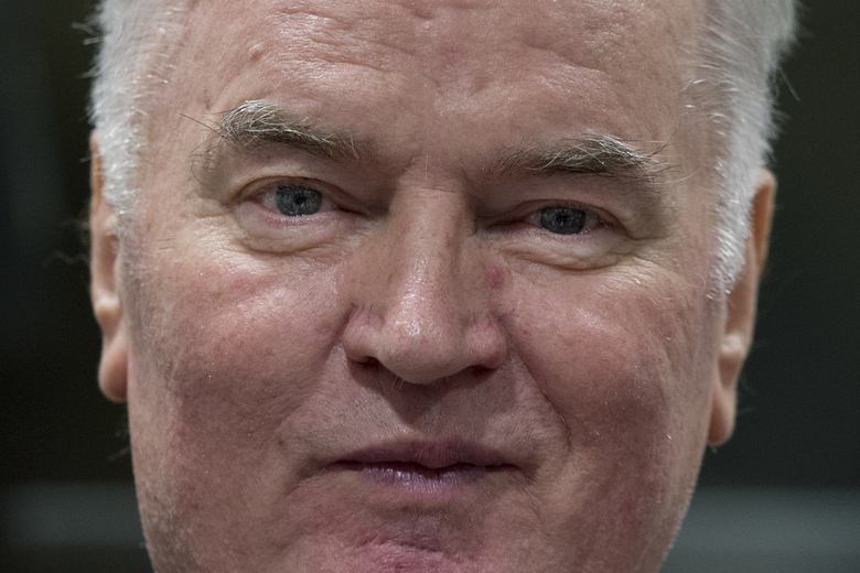 FILE – In this Wednesday, Nov. 22, 2017 file photo, Bosnian Serb military chief Ratko Mladic enters the Yugoslav War Crimes Tribunal in The Hague, Netherlands, to hear the verdict in his genocide trial. International judges on Wednesday March 11, 2020, postponed an appeal hearing for former Bosnian Serb military chief Ratko Mladic against his convictions on charges including genocide because Mladic is due to undergo surgery. (AP Photo/Peter Dejong, Pool)