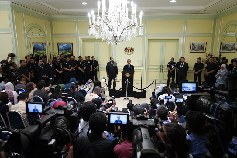 Malaysia's new prime minister, Muhyiddin Yassin, speaks during a press conference at the Prime Minister's office in Putrajaya, Malaysia, Monday, March 9, 2020. Muhyiddin unveiled his Cabinet on Monday, saying he will have no deputy but instead appointed four senior ministers in a move that helped him dodge the tricky issue of succession in his Malay-majority government. (AP Photo/Vincent Thian)