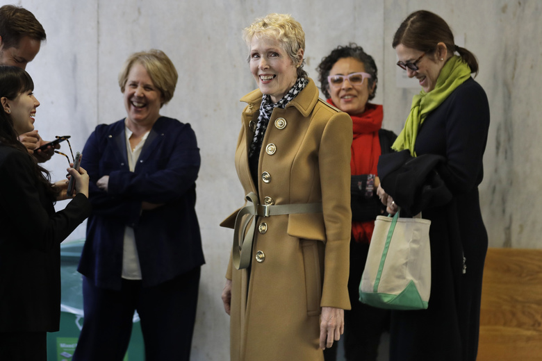E. Jean Carroll, center, waits to enter a courtroom in New York, Wednesday, March 4, 2020. As part of her defamation lawsuit against President Donald Trump, Carroll is seeking a DNA sample from him in an attempt to prove he raped her in the 1990s, which Trump denies. (AP Photo/Seth Wenig)