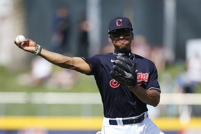 Cleveland Indians shortstop Francisco Lindor throws to first base to get Los Angeles Dodgers' Terrance Gore out during the second inning of a spring training baseball game Thursday, Feb. 27, 2020, in Goodyear, Ariz. The Dodgers won 6-5. (AP Photo/Ross D. Franklin)