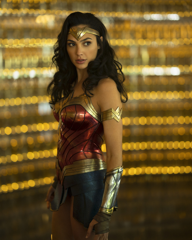 """This image released by Warner Bros. Pictures shows Gal Gadot as Wonder Woman in a scene from """"Wonder Woman 1984."""" Warner Bros. on Tuesday delayed the summer release of the film to Aug. 14 instead of June 5 due to the coronavirus pandemic. (Clay Enos/Warner Bros Pictures via AP)"""