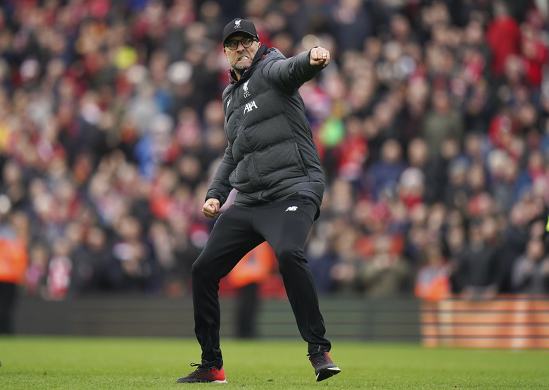 Liverpool's manager Jurgen Klopp celebrates at the end of the English Premier League soccer match between Liverpool and Bournemouth at Anfield stadium in Liverpool, England, Saturday, March 7, 2020. Liverpool won 2-1. (AP Photo/Jon Super)