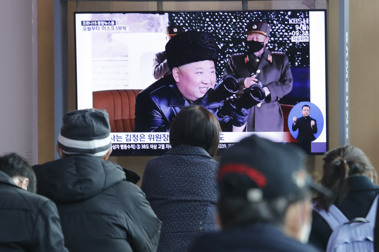 "People watch a TV showing a file image of North Korean leader Kim Jong Un during a news program at the Seoul Railway Station in Seoul, South Korea, Monday, March 9, 2020. North Korea fired three unidentified projectiles off its east coast on Monday, South Korea's military said, two days after the North threatened to take ""momentous"" action to protest outside condemnation over its earlier live-fire exercises. (AP Photo/Ahn Young-joon)"