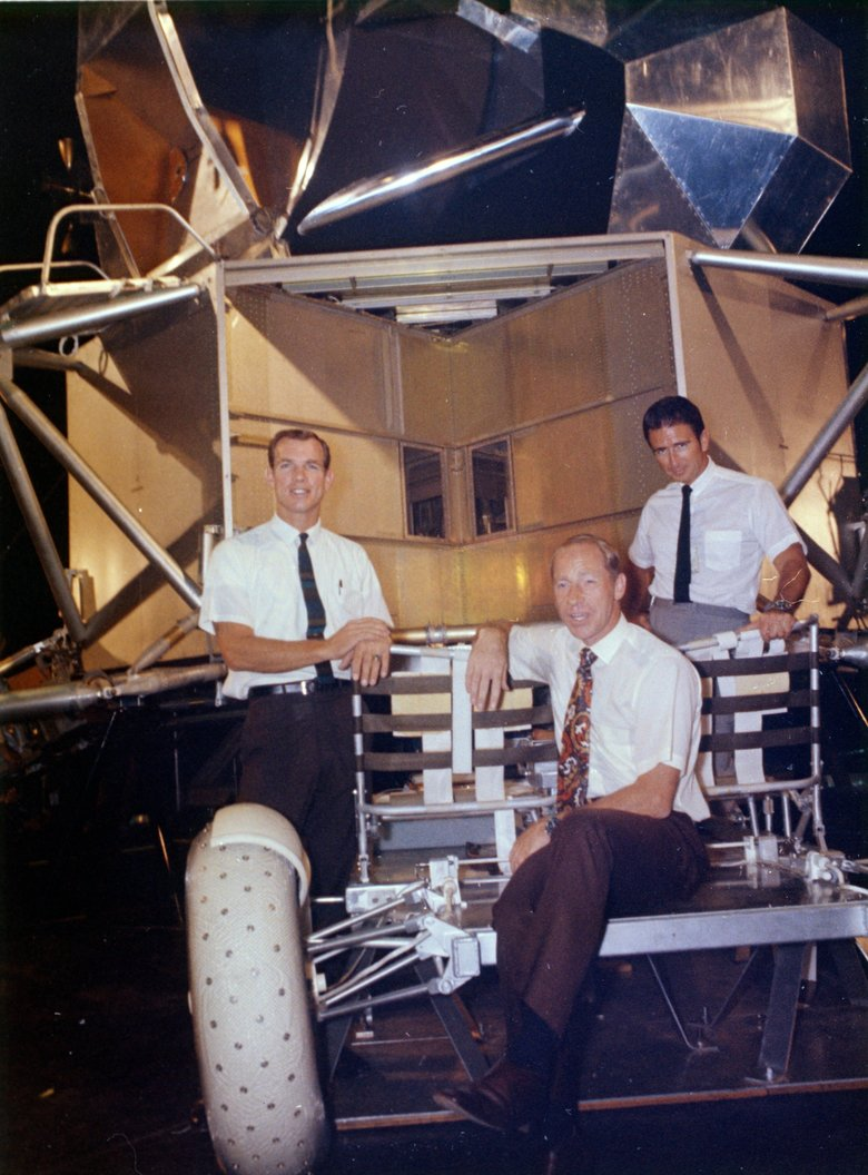 This undated photo made available by NASA shows astronauts Al Worden, center, Dave Scott, left, and Jim Irwin with a moon rover mock-up. Worden, who circled the moon alone in 1971 while his two crewmates tried out the first lunar rover, has died at age 88, his family said Wednesday, March 18, 2020. (NASA via AP)