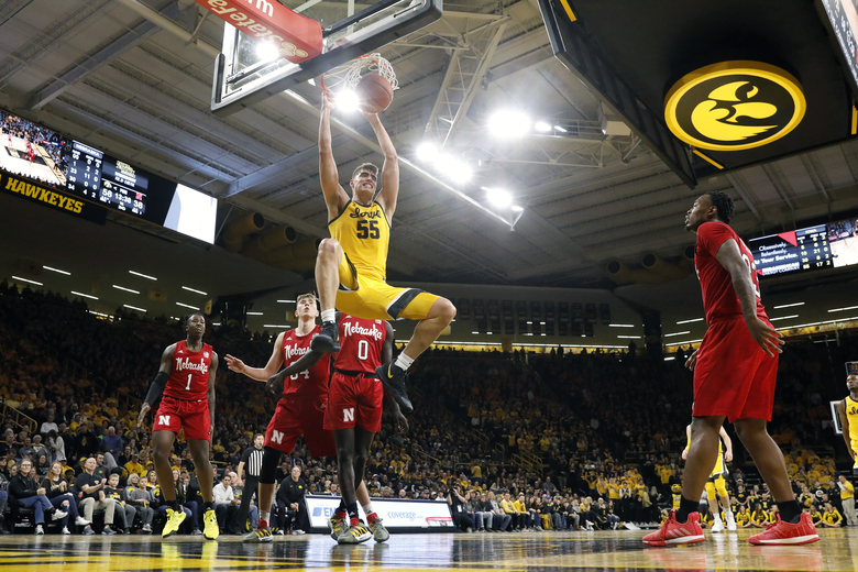 FILE – In this Feb. 8, 2020, file photo, Iowa center Luka Garza (55) dunks the ball during the second half of an NCAA college basketball game against Nebraska, in Iowa City, Iowa. Garza was selected to The Associated Press All-America first team, Friday, March 20, 2020.  (AP Photo/Charlie Neibergall, File)