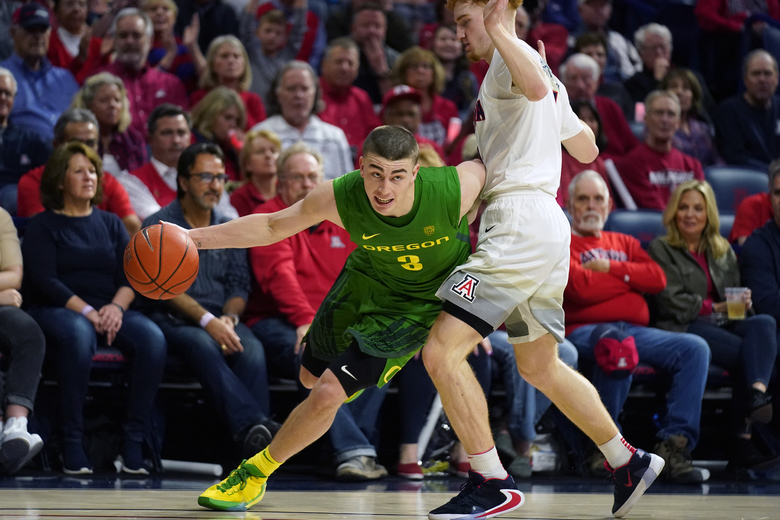 FILE – In this Feb. 22, 2020, file photo, Oregon guard Payton Pritchard (3) drives against Arizona during the first half of an NCAA college basketball game in Tucson, Ariz. Pritchard was selected to The Associated Press All-America first team, Friday, March 20, 2020. (AP Photo/Rick Scuteri, Fle)